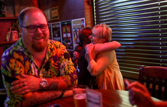 Casey Adams embraces Honey, the mother of one of Adams' regulars and who celebrated her 81st birthday that day at O'Connors Irish Pub and Grill in Clarksville, Tenn., on Friday, June 28, 2019.