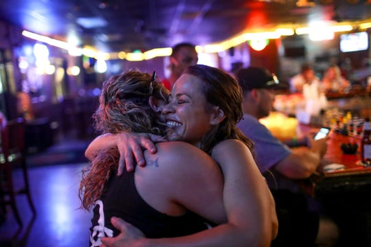 Casey Adams hugs Megan Haar, the second bartender on that night and one of her good friends at O'Connors Irish Pub and Grill in Clarksville, Tenn., on Friday, June 28, 2019.