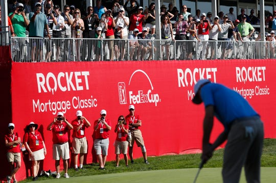 Spectators and staff use their phones to record Nate Lashley putt on the 18th green as he wins the Rocket Mortgage Classic tournament at the Detroit Golf Club in Detroit on Sunday, June 30, 2019.