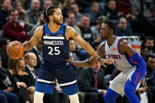 Timberwolves guard Derrick Rose is defended by Pistons guard Reggie Jackson in Minneapolis on Dec. 19, 2018.