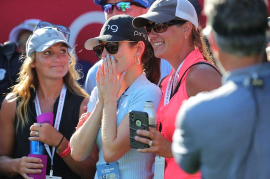 Ashlie Reed, center, reacts as her boyfriend Nate Lashley wins the Rocket Mortgage Classic tournament at the Detroit Golf Club in Detroit on Sunday, June 30, 2019.