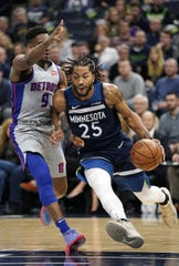 Timberwolves' Derrick Rose drives the ball against the Pistons' Langston Galloway in Minneapolis on Dec. 19, 2018.