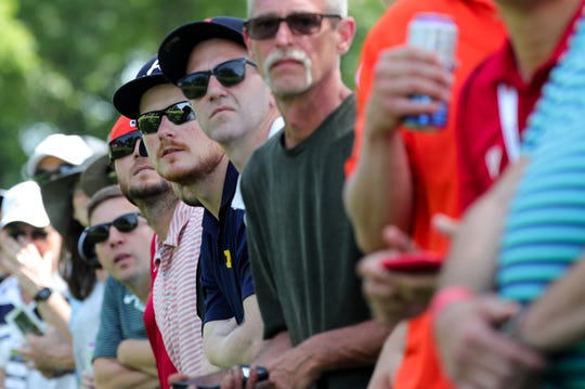 Spectators watch the action during the final round of the Rocket Mortgage Classic at the Detroit Golf Club in Detroit on Sunday, June 30, 2019.