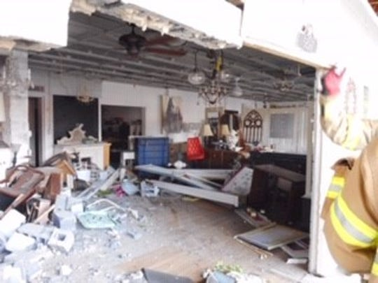 The interior of Brose Electric Shop in Independence Township after a car smashed through the storefront.