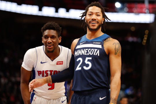 Timberwolves guard Derrick Rose shares a laugh with Pistons guard Langston Galloway during the third quarter at Little Caesars Arena, March 6, 2019.