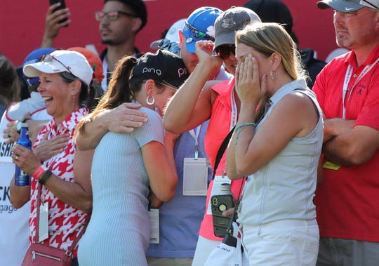Brooke Lashley, right, covers her face as she watches her brother Nate Lashley win the Rocket Mortgage Classic at the Detroit Golf Club in Detroit on Sunday, June 30, 2019.