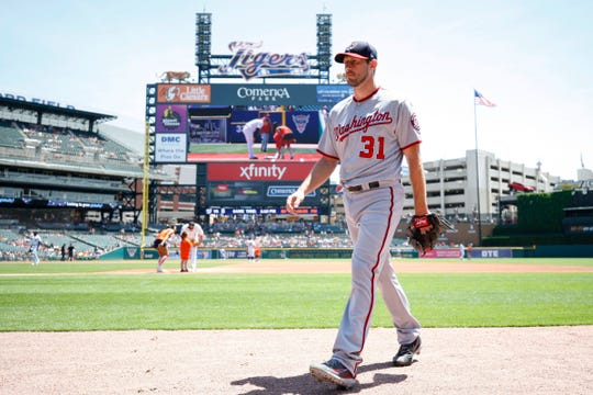 Washington Nationals starting pitcher Max Scherzer walks to the dugout before his first start in his return to Comerica Park against the Detroit Tigers, Sunday, June 30, 2019.