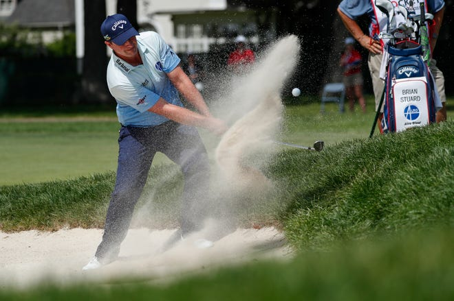 Brian Stuard plays out of a bunker at the 11th green during the final round of the Rocket Mortgage Classic at the Detroit Golf Club in Detroit on Sunday, June 30, 2019.