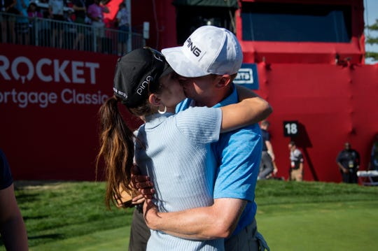 Nate Lashley kisses his girlfriend Ashlie Reed after winning the Rocket Mortgage Classic tournament at the Detroit Golf Club in Detroit on Sunday, June 30, 2019.