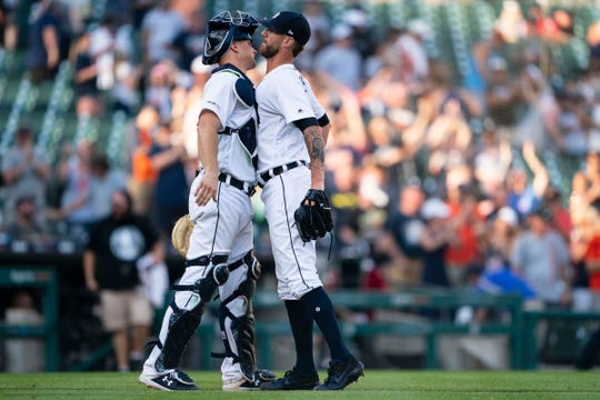 Detroit Tigers catcher John Hicks and pitcher Shane Greene chest bump to celebrate the 7-5 victory against the Washington Nationals at Comerica Park, June 29, 2019.