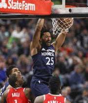 Timberwolves guard Derrick Rose dunks against the Rockets in the fourth quarter March 18, 2019 in Minneapolis, Minn.
