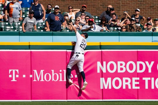 Detroit Tigers center fielder JaCoby Jones leaps and reaches over the fence to make a catch, robbing Washington Nationals center fielder Victor Robles of a home rum during the third inning at Comerica Park, June 29, 2019.