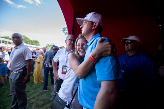 Nate Lashley gets a hug from his sister Brooke Lashley after he won the Rocket Mortgage Classic.