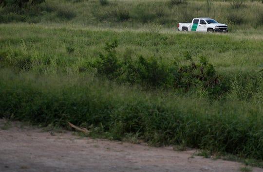 A U.S. Border Patrol car drives along the Rio Grande in Brownsville, Texas, as seen from Matamoros, Tamaulipas state, Mexico, Thursday, June 27, 2019.