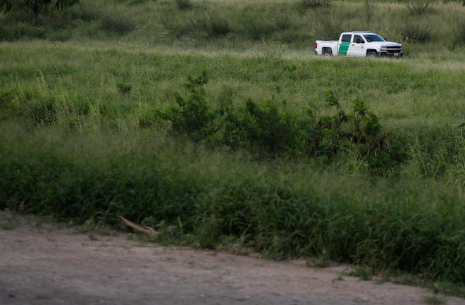 A U.S. Border Patrol car drives along the Rio Grande in Brownsville, Texas, as seen from Matamoros, Tamaulipas state, Mexico, Thursday, June 27, 2019.