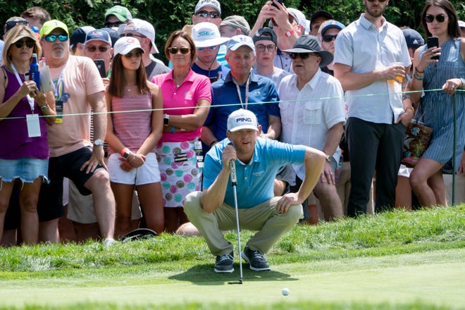 Nate Lashley studies his shot on the second hole during the final round of the Rocket Mortgage Classic golf tournament Sunday.