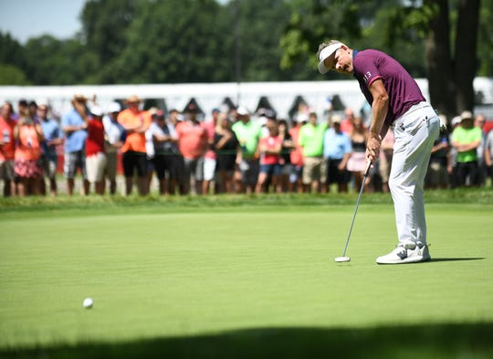 Luke Donald watches his long putt on the 10th hole during the final round of the Rocket Mortgage Classic on Sunday.
