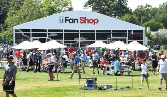 Spectators in the Fan Zone near the PGA Tour Fan Shop.