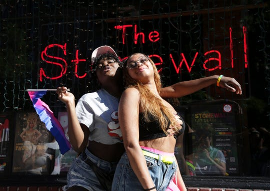 Celia Gooding, left, and Laila Kelly pose for a picture in front of the Stonewall Inn before the Queer Liberation March in New York, Sunday.