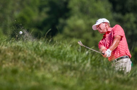 Steve Stricker hits out of a bunker on the second hole during the third round of the U.S. Senior Open on Saturday.