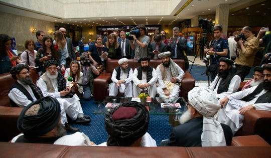 "In this file photo taken on Tuesday, May 28, 2019, Mullah Abdul Ghani Baradar, the Taliban group's top political leader, left, Sher Mohammad Abbas Stanikzai, the Taliban's chief negotiator, second left, and other members of the Taliban delegation speak to reporters prior to their talks in Moscow, Russia. The seventh and latest round of peace talks between the U.S. and Taliban is ""critical,"" said Taliban spokesman Suhail Shaheen on Sunday."