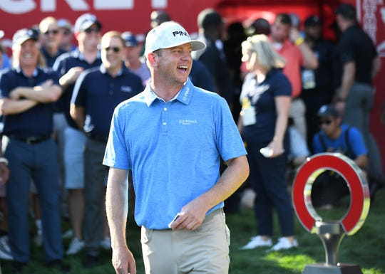 Nate Lashley is all smiles before receiving the trophy of his first PGA Tour win at the Rocket Mortgage Classic at the Detroit Golf Club.