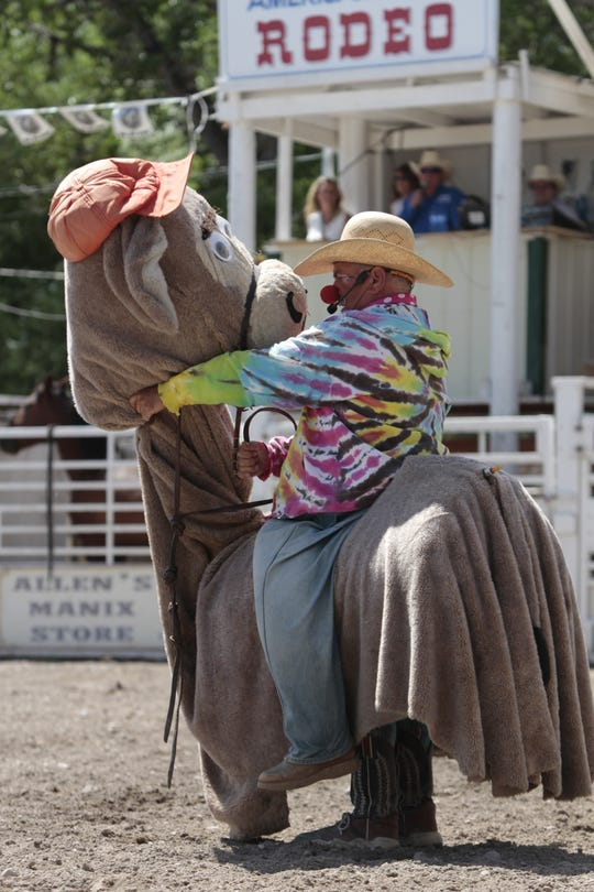 Rodeo clown Donnie Landis performs an act during the 83rd annual Augusta American Legion PRCA Rodeo Sunday.