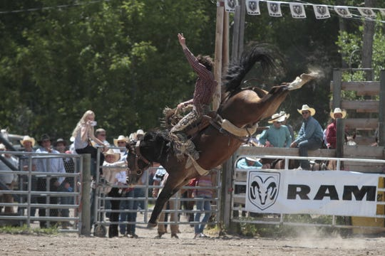 Saddle bronc rider Tanner Hollenback from Dillon riding Next 2 U