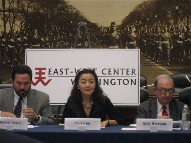 Yuri Kim, center, former North Korea unit chief at the U.S. Department of State, briefs Congressional staff during an East-West Center sponsored briefing in 2006. Pictured, from left, are: Michael Green, Georgetown University; Kim; and Selig Harrison, Center for International Policy.