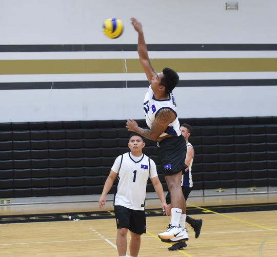 Members of the Guam Men's National Volleyball Team work on drills during a practice at the Tiyan High School Gym on June 29, 2019.