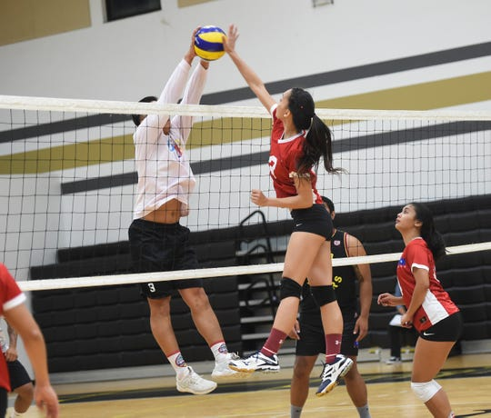 The Guam Women's National Volleyball Team competes in a scrimmage during a practice at the Tiyan High School Gym on June 29, 2019.
