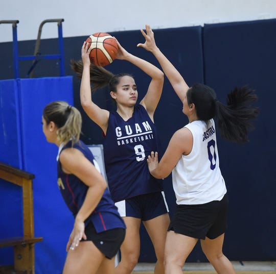 Mia San Nicolas is guarded by Kathryn Castro during a Guam Women's National Basketball Team practice at the Saint Paul Christian School Gym in Dededo on June 28, 2019.