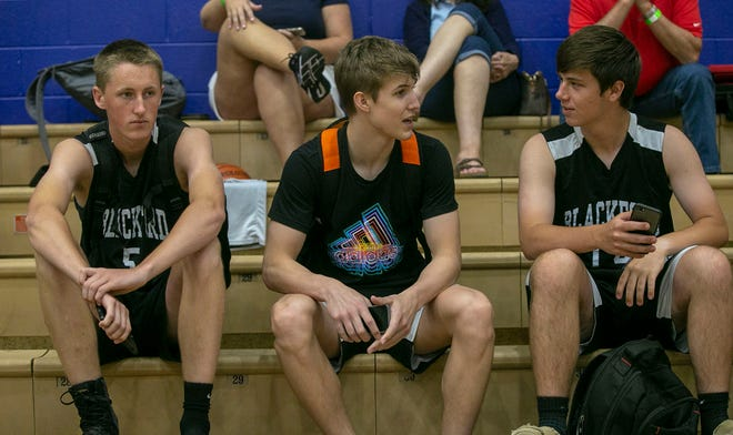 Blackford High School basketball player Luke Brown, middle, talks with teammates during the 15th annual Charlie Hughes Shootout held at Hamilton Southeastern, Sunday, June 30, 2019, Fishers, IN.