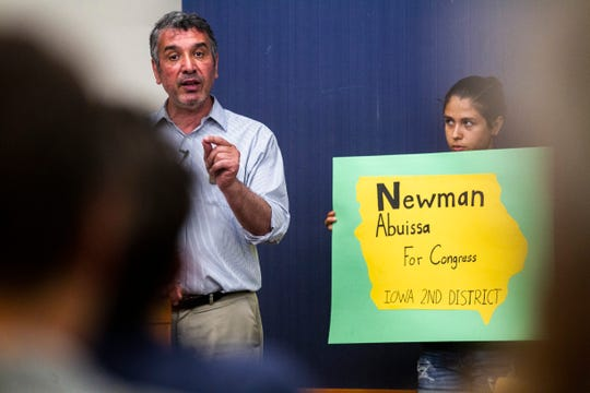 Newman Abuissa, transportation engineer and Democratic candidate for Iowa's 2nd Congressional District, announces his bid for U.S. Representative, Sunday, June 30, 2019, at the Public Library in downtown Iowa City, Iowa.