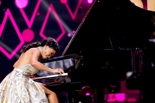 Brianna Mason plays the piano during the final round of the Miss Tennessee Scholarship Competition on June 29.