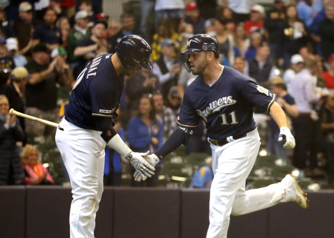 Yasmani Grandal (left) and Mike Moustakas, who both fell just short in All-Star Game starters vote, learned they made the NL roster for the Midsummer Classic thanks to the vote of their peers.