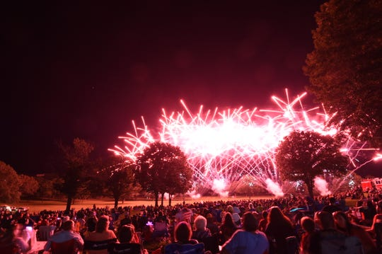 Spectators watch the fireworks display that capped the 20th annual Red, White and Blue Festival last year. Organizers have canceled this year's festival but plan to return in 2021.