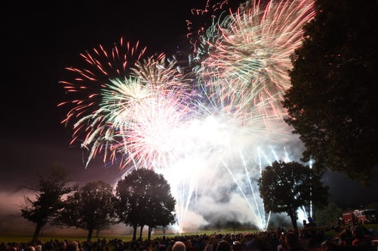 A large crowd looks on Saturday night on the Arkansas State University Mountain Home campus as some of the final fireworks of the 20th Annual Red White & Blue Festival burst overhead. Go to www.baxterbulletin.com to see photo galleries of the parade and the fireworks show.