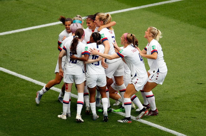 United States' Megan Rapinoe celebrates with teammates after scoring her side's first goal during the Women's World Cup quarterfinal soccer match between France and the United States at the Parc des Princes, in Paris, Friday, June 28, 2019. (AP Photo/Francois Mori)