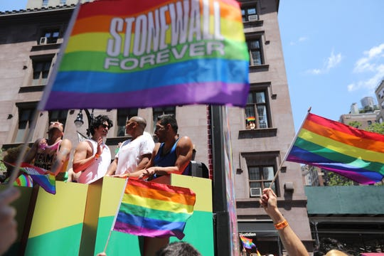 The Pride March rolls down 8th St. with a sea of rainbow flags on Sunday.