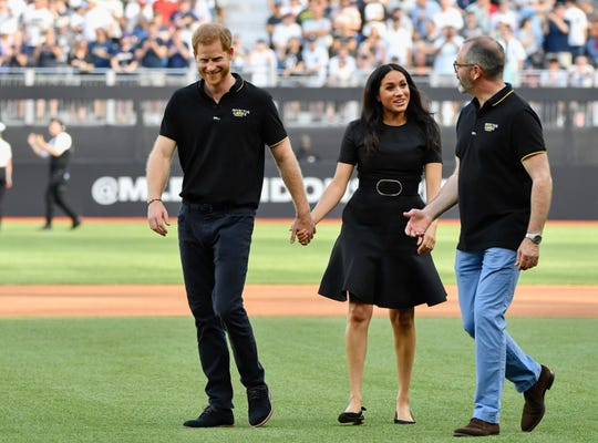 Prince Harry, Duke of Sussex and Meghan, Duchess of Sussex, before game between the Boston Red Sox and the New York Yankees at London Stadium.
