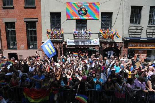 People celebrate Pride March in front of the historic Stonewall Inn. Sunday June 30, 2019