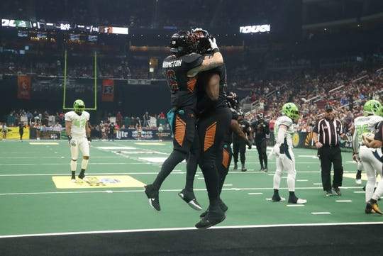 Rattlers' Jarrod Harrington (16) and Brandon Haskins (99) celebrate a Harrington touchdown against the Danger during the Conference Championship at Gila River Arena in Glendale, Ariz. on June 29, 2019.