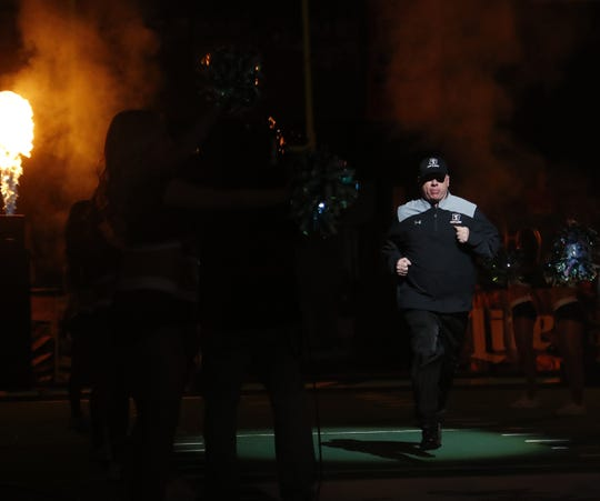Rattlers' head coach Kevin Guy heads onto the field before a game against the Danger during the Conference Championship at Gila River Arena in Glendale, Ariz. on June 29, 2019.