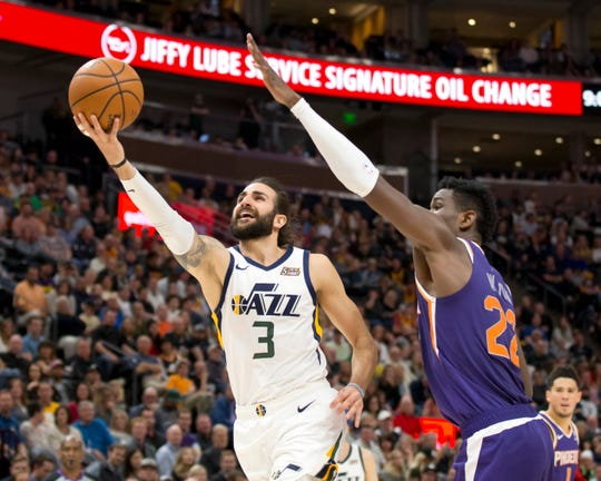 Mar 25, 2019: Utah Jazz guard Ricky Rubio (3) shoots the ball against Phoenix Suns center Deandre Ayton (22) during the second half at Vivint Smart Home Arena.