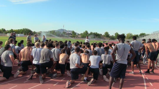 Perry High coach Preston Jones talks with his team after a morning workout June 27th at the high school.