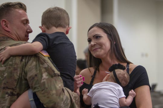 Families celebrate the return of their soldiers at the Allen Readiness Center at Papago Park Military Reservation in Phoenix, Ariz. on June 29, 2019. Friends and families welcomed home the Arizona National Guard's 856th Military Police, Det. 1 soldiers from their deployment to Afghanistan.