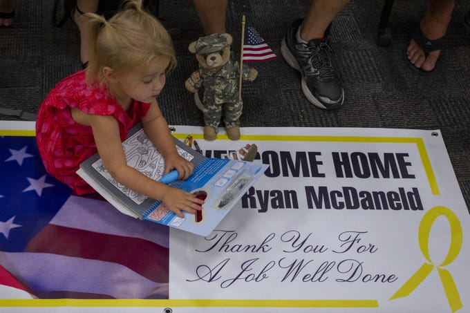 Paislee McDoneld, 2, eagerly waits for her dad at the Allen Readiness Center at Papago Park Military Reservation in Phoenix, Ariz. on June 29, 2019. Friends and families welcomed home the Arizona National Guard's 856th Military Police, Det. 1 Soldiers from their deployment to Afghanistan.