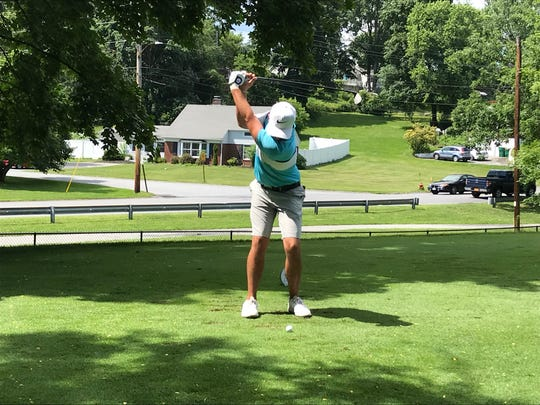 Nick Dilio swings his driver at the Dutchess County Amateur on Sunday.