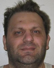 A mug shot photo of Avram Nika, now 49, who was convicted of first-degree murder for the death of Fallon resident Edward Smith. He was sentenced to death in 1995.